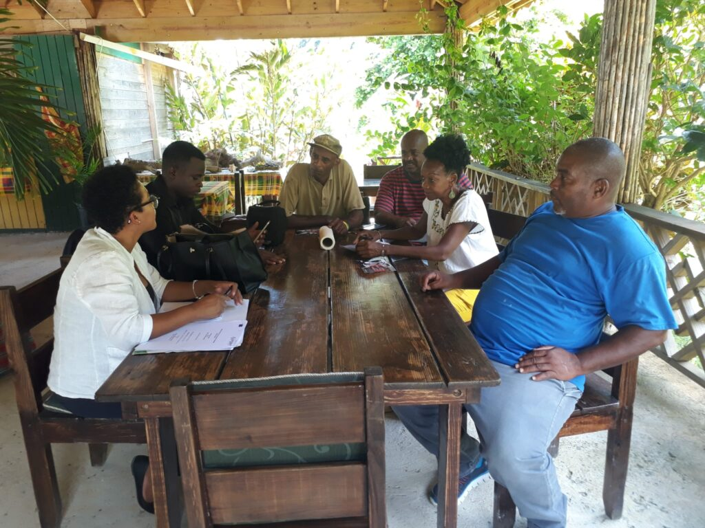 Caribbean Export evaluators meet with RWR team following completion of Solar Energy System